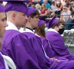 Graduating seniors listen to commencement addresses by classmates.