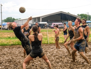 Balls in Your Face take on the the Ball Busters in mud volleyball competition Sunday.
