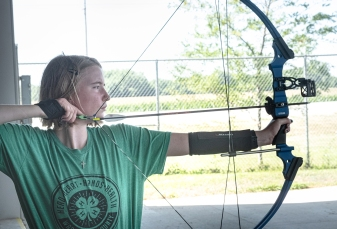 Sarah Rhea from Arlington competes in Archery competition Saturday.