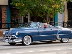 Greek Abariotes driving his early 1950's Pontiac convertible and wife Marilyn tour downtown Blair on Cruise Night.