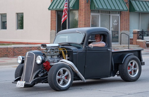 Hotrod Chevy pickup cruises Washington Street.