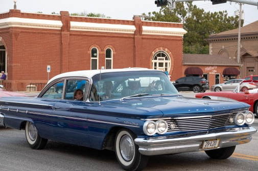 Mike Jones and grandkids cruise by in a '60's Pontiac Star Cheif.