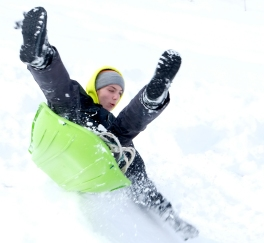 Toby Ray hits flies over a snow ramp at Steyer Park /Sunday afternoon.